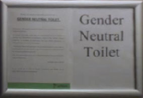sign on door of gender neutral toilet - click to embiggen